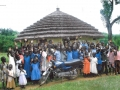 In 2010 A.W paid for this motor bike, which has enabled Fr. Charles Odwar Onama, A.J. to visit prayer houses, chapels and to say mass in Northern Uganda. Thats the church behind the children.